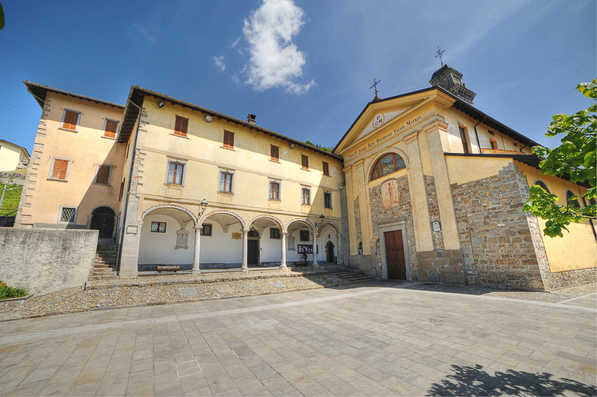 The square and the porch of the Arcipresbiterale Church of Dossena